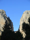 Bridge and Rockscape in gorge Royalty Free Stock Image