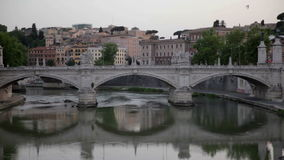 Bridge in Rome, Italy. Breathtaking bridge over Tiber river and seeing different buildings in Rome, Italy stock video