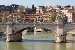 Bridge in Rome. Rome scenery, bridge in foreground. Colorful typical houses in background. Sunny day, perfect for a walk Stock Images
