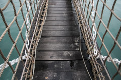 Bridge. Rope bridge in the sea Stock Photography