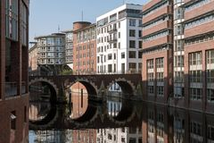 Bridge with round reflection over a fleet, a typical waterway in. Hamburg, germany, the old Ellerntorsbrücke leads from the city over the Herrengrabenfleet to Royalty Free Stock Photography