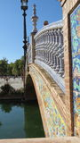 Bridge at the Royal Alcazar Palace in Seville, Spain. Bridge with mosaic and ornate stonework in Seville, Andalucia, Spain Stock Photo