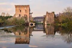 Bridge ruins reflections at Borghetto Valeggio sul Mincio near M. Reflections of ancient bridge in water of Mincio River at Borghetto, Valeggio sul Mincio Stock Image