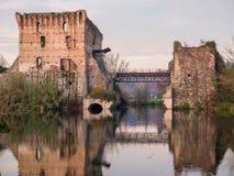 Bridge ruins reflections at Borghetto Valeggio sul Mincio near Mantova. Reflections of ancient bridge in water of Mincio River at Borghetto, Valeggio sul Mincio Stock Images