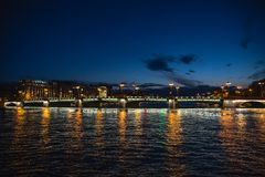 Bridge in Saint-Petersburg with lights illumination in summer white night, Neva river. Toned Royalty Free Stock Photo