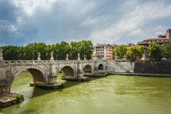 Bridge Sant Angelo over river Tiber. View on a bridge Sant Angelo over river Tiber from the Castle of Saint Angel towards modern city of Rome Italy stock photos