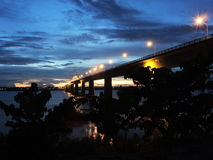 Bridge Savannakhet to Mukdahan in twilight. Friendshipbridge II connecting Mukdaharn in Thailand and Savannakhet in Laos. No PP Royalty Free Stock Photography