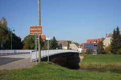 Bridge in Schweinitz (Jessen) in Germany. Bridge in Schweinitz in Germany, view to the church Stock Photography