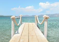 Summer bridge. Bridge in the sea on the background of sea Royalty Free Stock Photos