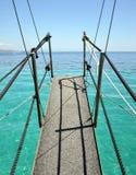 Bridge into the sea. Footbridge suspended on ropes into the sea Stock Photo
