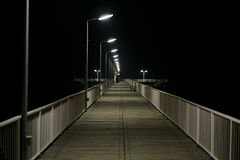 Bridge on the sea. Illuminated bridge over the sea at night Royalty Free Stock Photos