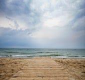 Bridge into the sea - loneliness concept Stock Photography
