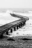 Bridge in the sea. Nice bridge in the sea in normandie with rough sea stock photos