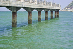Bridge in the sea Royalty Free Stock Photo