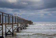 The Bridge on the sea. Storm tempesta mare mosso gabbiani seagull ponte water Sea mare nature spiaggia Stock Images