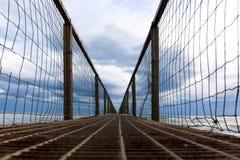 The Bridge on the sea. Storm tempesta mare mosso gabbiani seagull ponte water Sea mare nature spiaggia Royalty Free Stock Photo