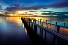Bridge into the sea Stock Photo