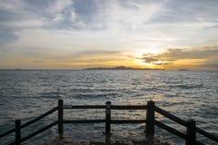Bridge and sea sunset background stock photos