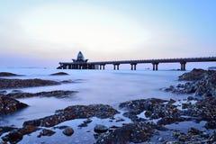 Bridge in the sea Stock Images