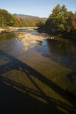 Bridge shadow on Pemigewasset River, White Mountains, New Hampsh Royalty Free Stock Photo