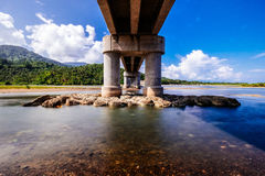 Bridge. Shot under the bridge. When river meets the sea Royalty Free Stock Images
