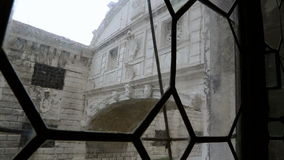 Bridge of sighs through the ancient window stock video footage