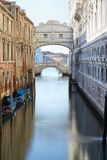 Bridge of Sighs and calm water in the canal, morning in Venice stock images
