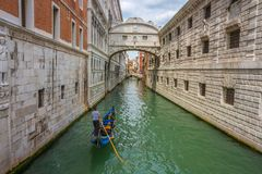 Bridge of Sighs famous landmark in Venice, Italy. Scenic view of Venice narrow canal with old architecture Stock Photography