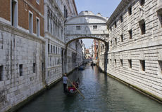 The Bridge of Sighs and a gondolier navigating. Venice, Italy: The Bridge of Sighs and a gondolier navigating.  It passes over the Rio di Palazzo and connects Royalty Free Stock Photos