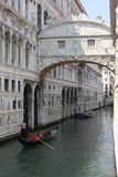 The Bridge of Sighs and a gondolier navigating. Venice, Italy: The Bridge of Sighs and a gondolier navigating.  It passes over the Rio di Palazzo and connects Stock Photo