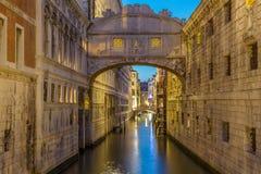 Bridge of Sighs Ponte dei Sospiri illumitaed at blue hour sunset night in Venice, Italy. Famous landmark. Stock Image