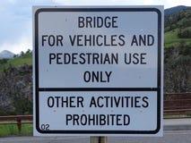 A bridge sign prohibiting any activity stock photo