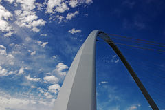 Bridge and sky. Bridge support arching into blue sky royalty free stock photo