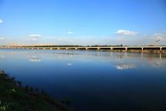 Bridge and sky. A bridge over the lake Stock Photos