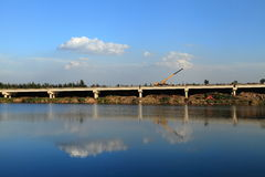 Bridge and sky. A bridge under construction over the lake Royalty Free Stock Images