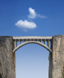 Bridge and Sky. Stone bridge connecting two cliffs