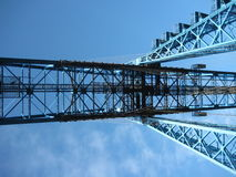 Bridge and Sky. Image showing the underside and structure of a moving bridge, painted blue, against a clear sky Stock Photos