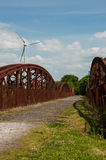 Bridge and sky. Old rusty bridge and wind turbine in bright,sunny day near Killorglin,Kerry,Ireland Stock Photos