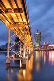 Bridge and skyscraper. In night, famous landmark in Macao, China Stock Photography
