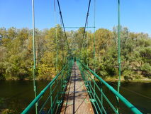 Bridge through the small river Psel. Royalty Free Stock Photography