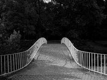 Bridge. Small white bridge with trees in background Royalty Free Stock Photography