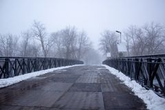 Bridge in a snowing day Niagara Falls State Park stock photography