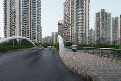 A bridge and some modern buildings in Putuo district over the Wusong river. Residential skyscrapers in Shanghai, China.  stock photos
