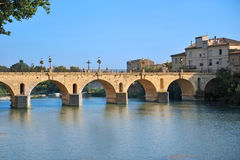 Bridge of Sommieres city. With the Vidourle river Stock Photos