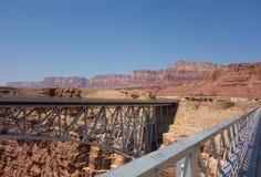 A bridge spanning a colorful canyon near lake powell Royalty Free Stock Photo