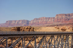 A bridge spanning a colorful canyon near lake powell Stock Images