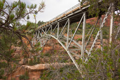 A bridge spanning a colorful canyon at sedona Stock Images