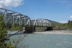 A bridge spanning a large river. Stock Photo