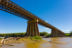 A bridge spanning the liard river in northern bc Royalty Free Stock Photos