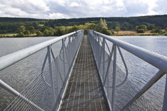Bridge spanning over a lake Royalty Free Stock Images
